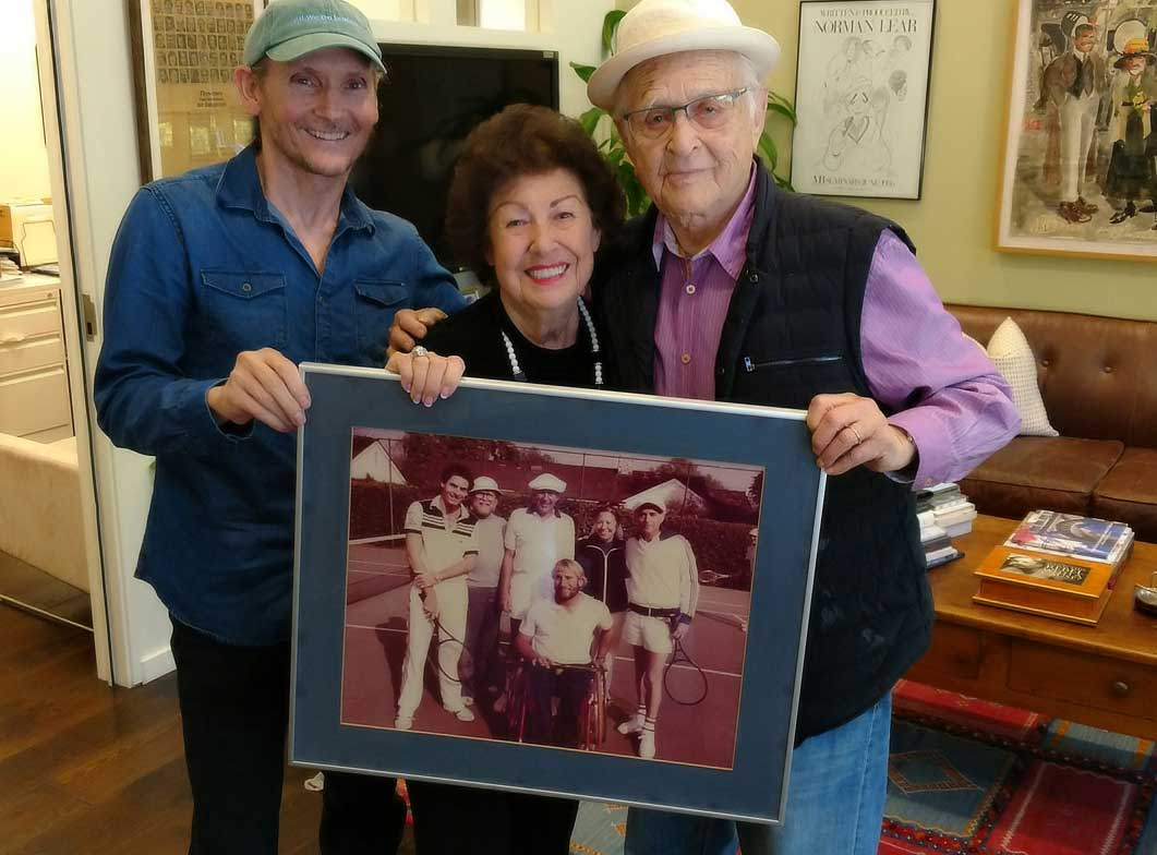 Chet Cooper, Fern Field and Norman Lear. Fern giving Norman a nostalgic picture of an epic day on the tennis court.